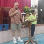 Robert preaching at a church service