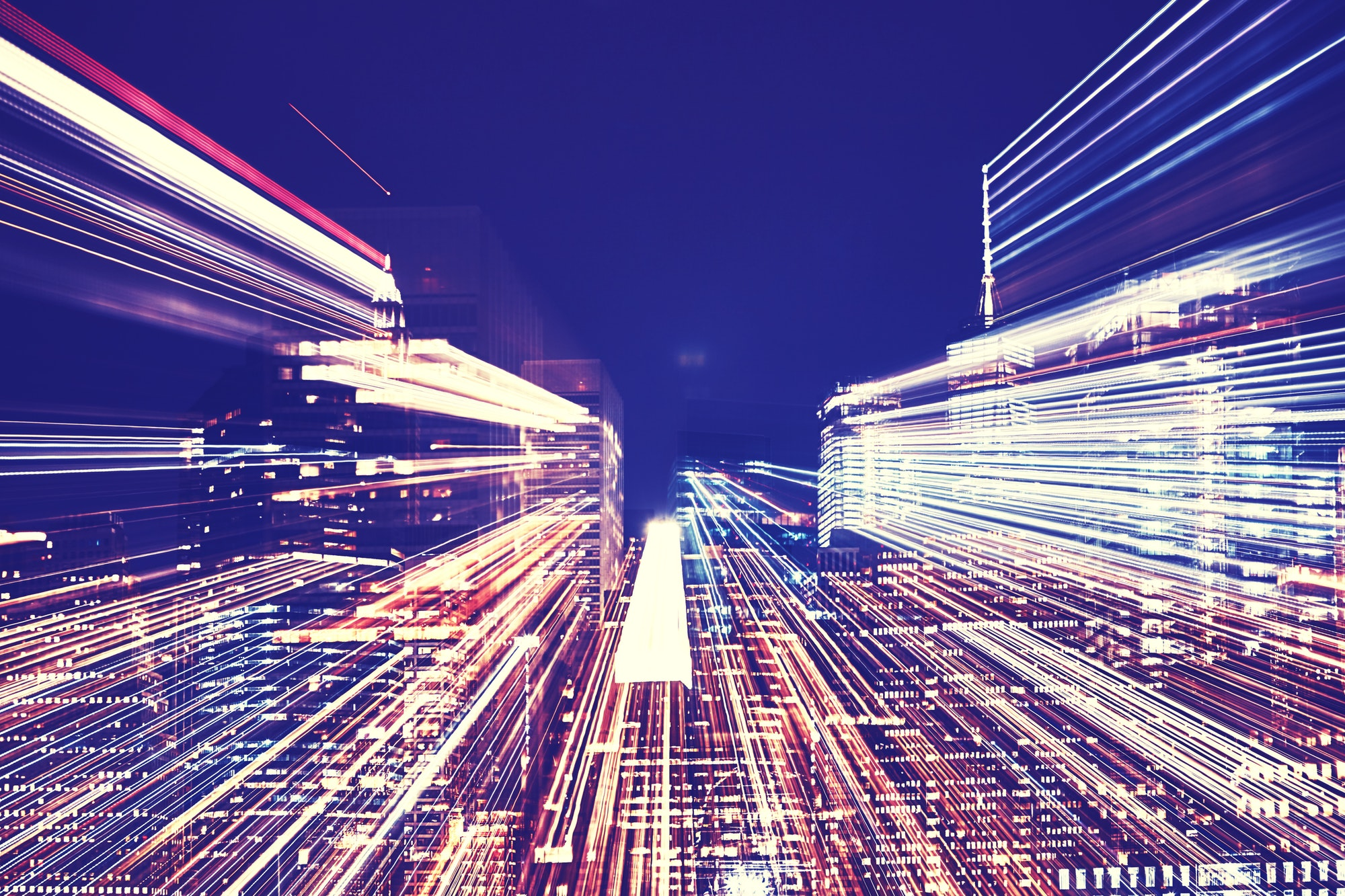 New York City night skyline with futuristic zoom effect.