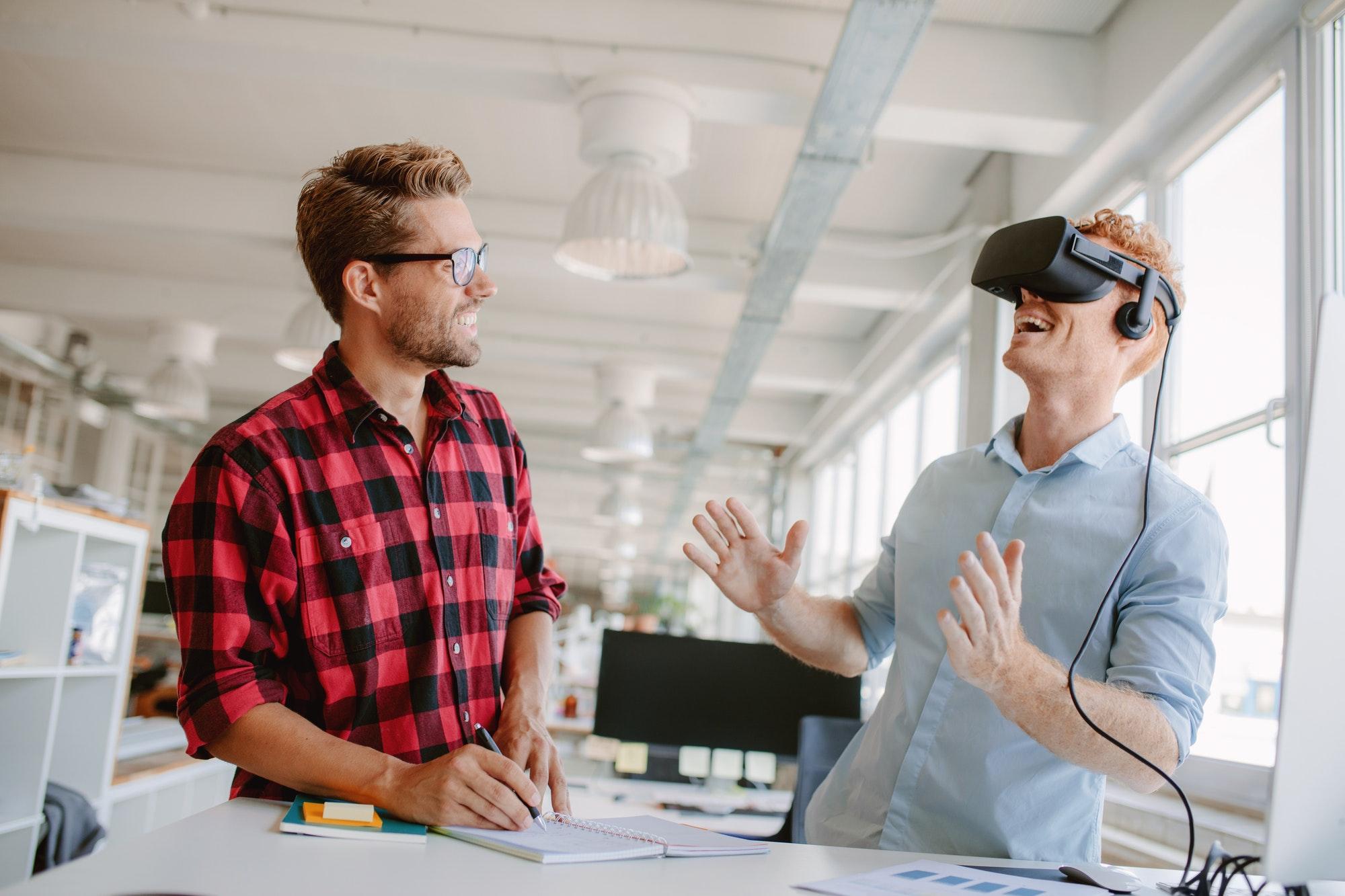 Young men testing virtual reality technology