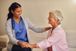 hispanic young women nurse and woman patient