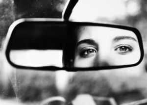 WOMANS EYES IN REAR VIEW MIRROR