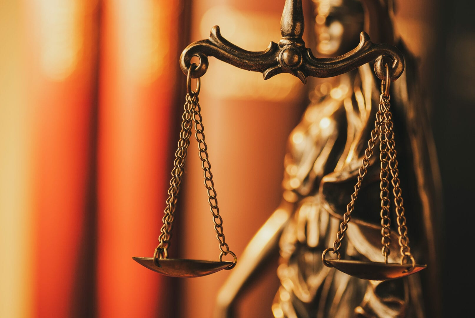 brass-scales-of-justice-in-a-close-up-view-MN6ZJSB