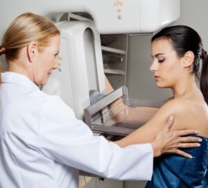 Doctor prepping patient for mammogram