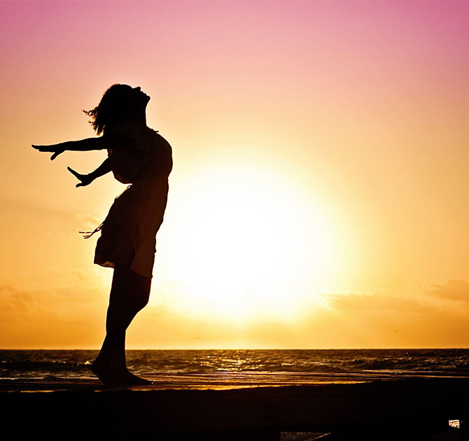 Lady enjoying sunset