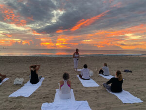 Stress Less Yoga - StressLess Yoga Retreat -Mind Mind Body Spirit Retreat - Ladies doing yoga on the beach