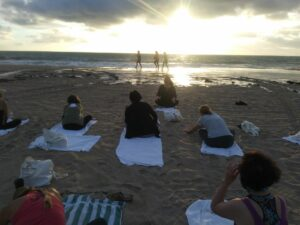 View of yoga class watching the sunset