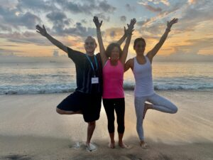 Three yoga students posing together