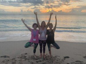 Three yoga friends posing together