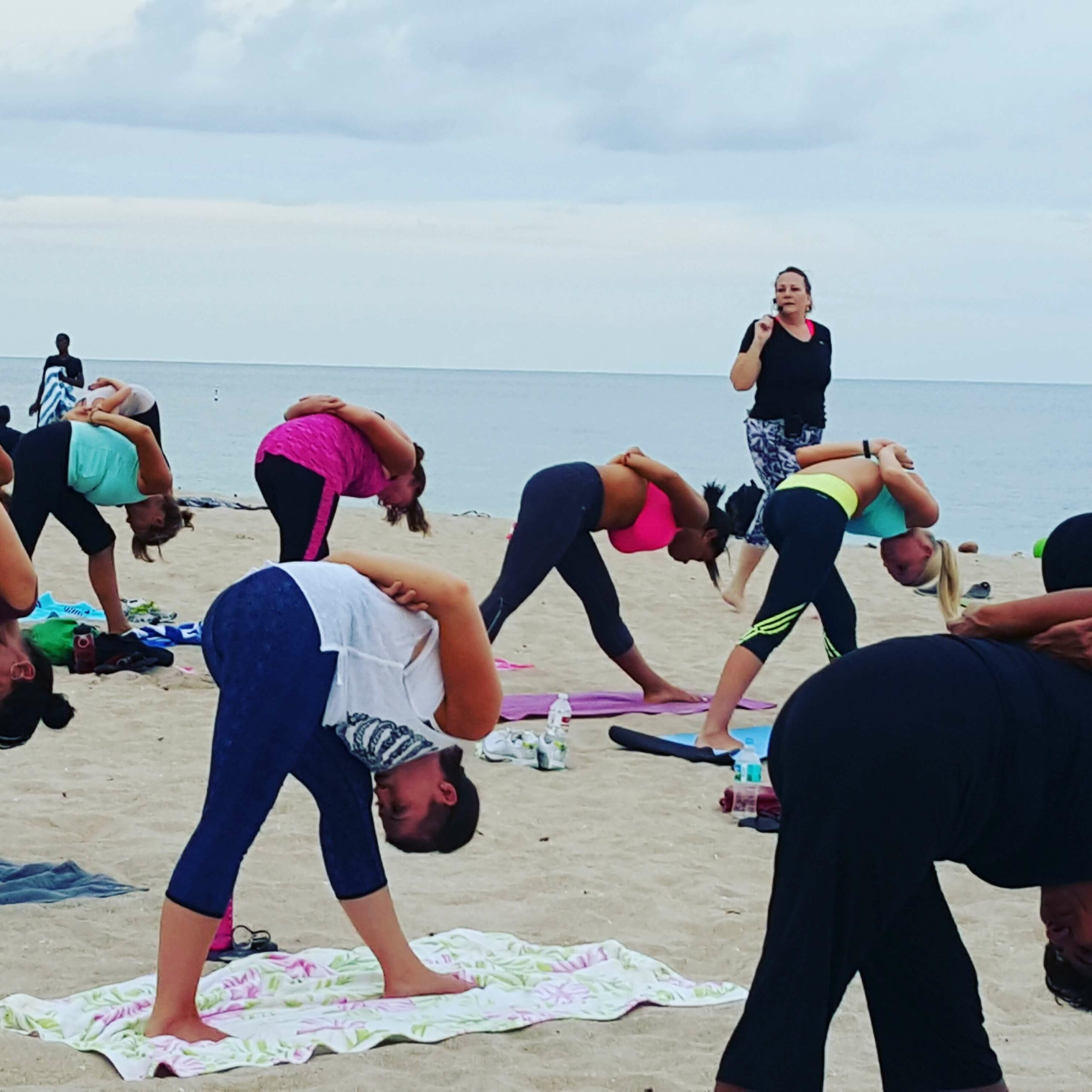View of students stretching on the beach