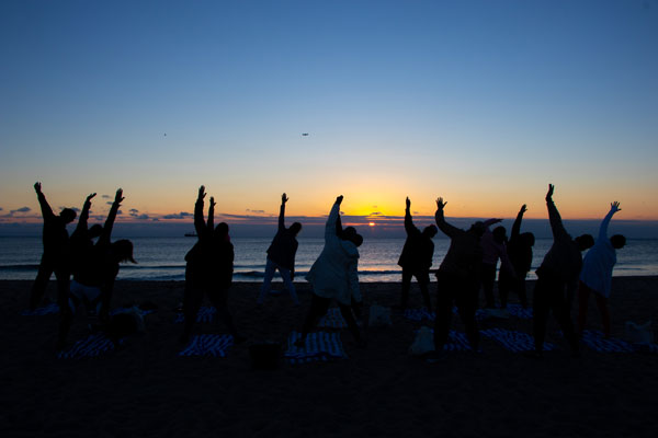 Come Join us: Yoga Class on the beach during a beautiful sun set