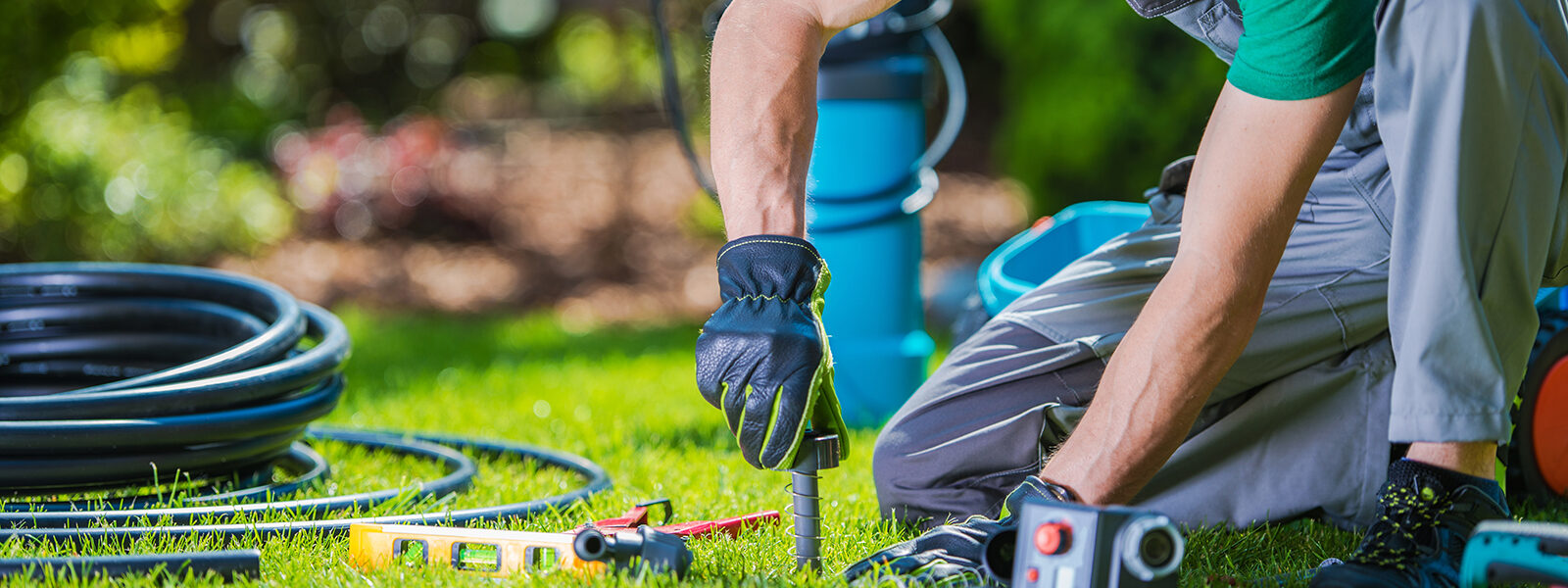 Garden Automatic Watering Systems Installer. Garden System Technician at Work.