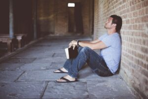 a grieving man reading the Bible