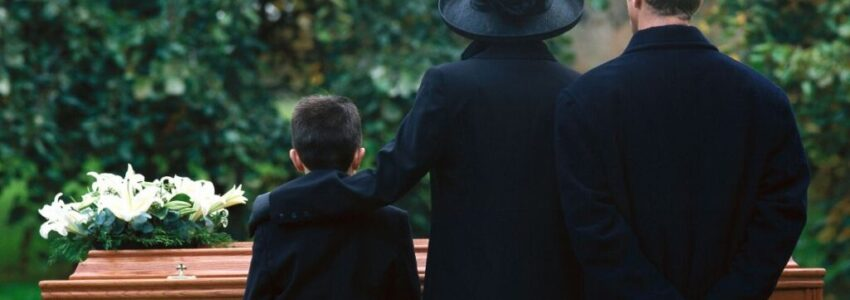 A family attending a funeral.
