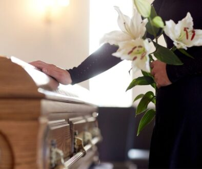 a picture of a man holding a casket and knows what not to wear to a wake