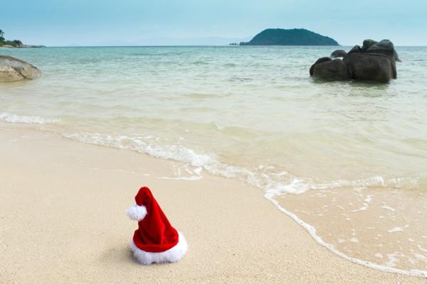 Santa on beach vacation