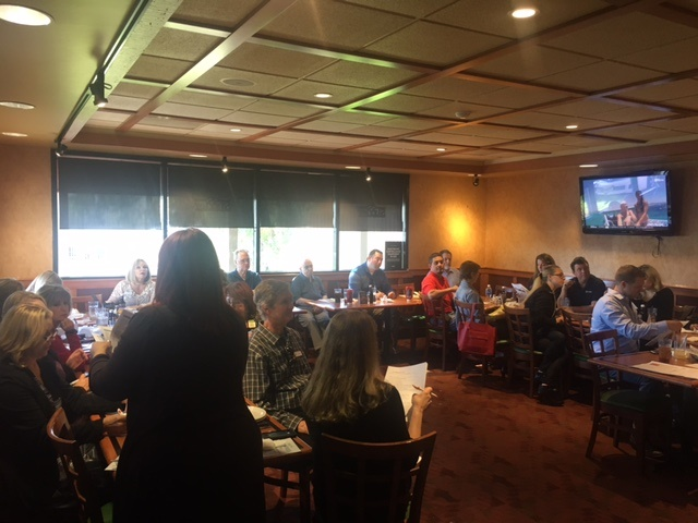 Ambassadors gather at a recent program lunch to discuss upcoming events.