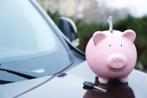 Piggybank for saving money on car insurance