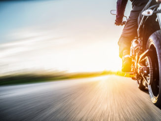 picture of person on motorcycle with great view of road and horizon
