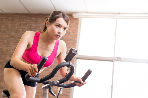 woman excising on a stationary bike that she owns