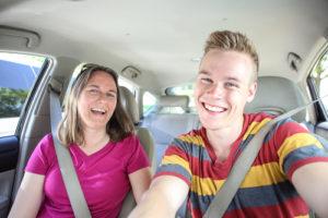 Happy male teenage driver