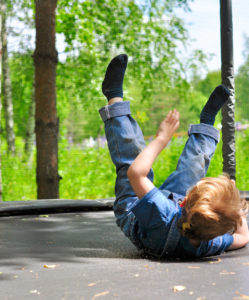 Child falling on a trampoline