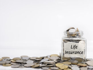 photo of a pile of money and the text written life insurance