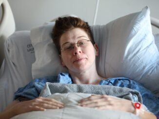 Woman sick in the hospital