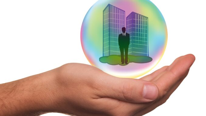 image of business person and workplace in bubble on hand