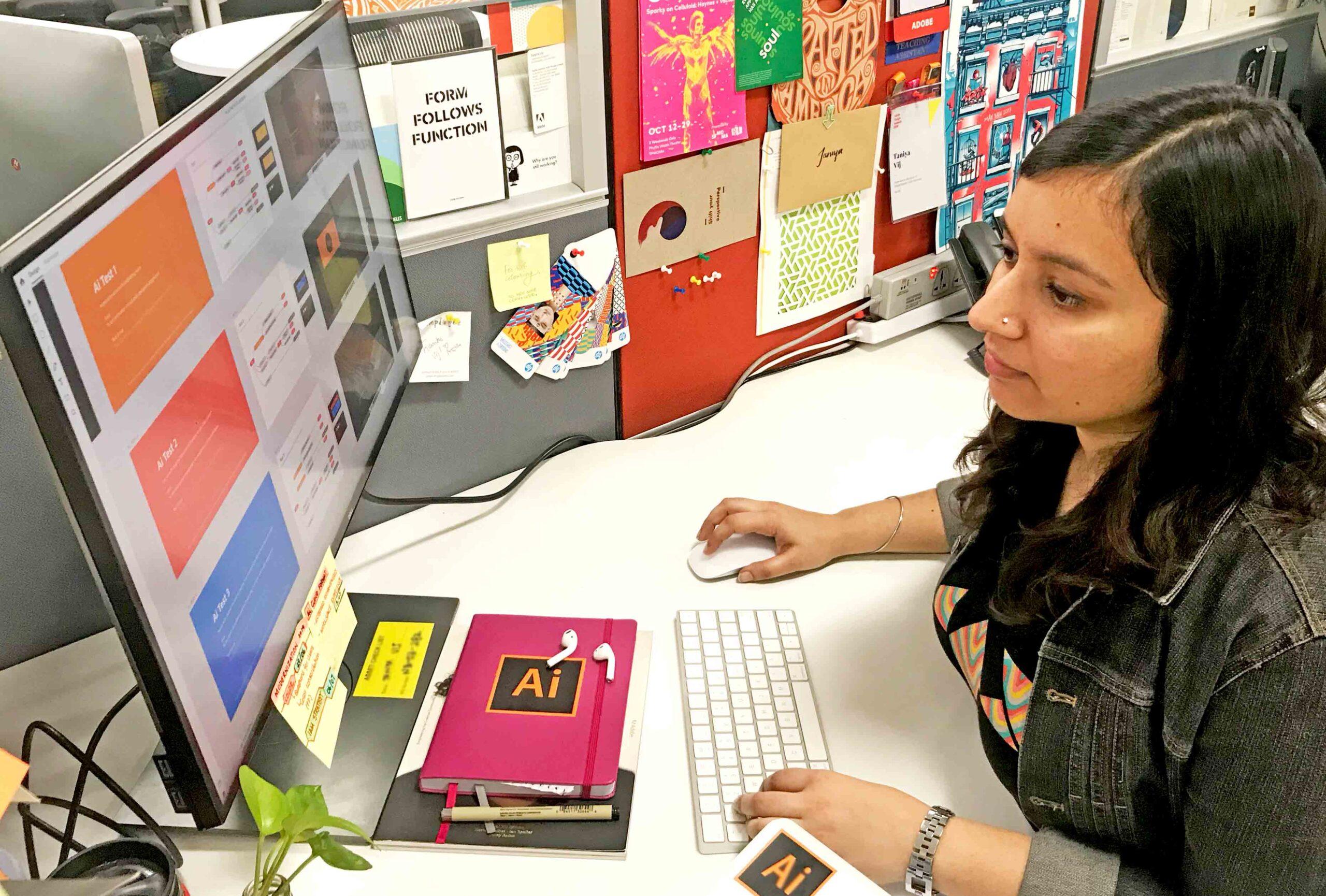 Taniya on her desk at work