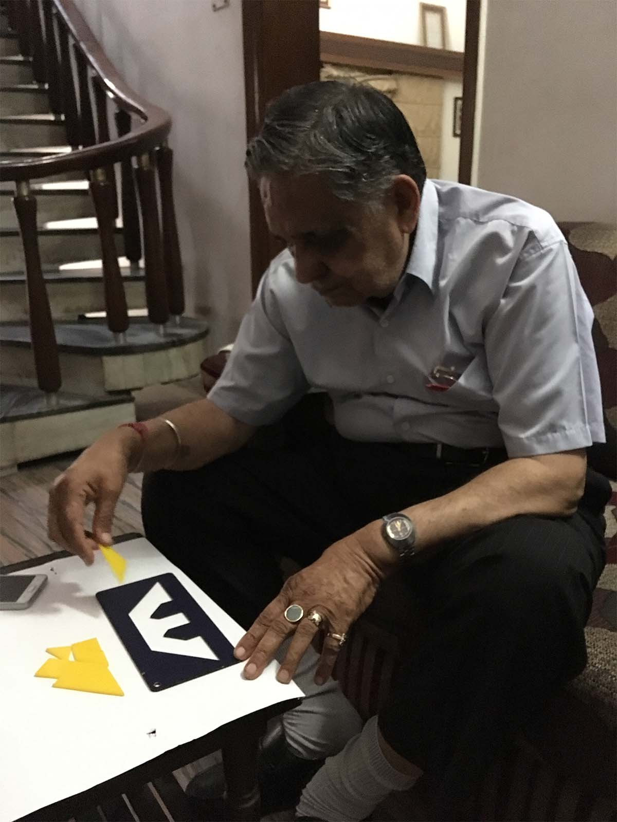 My 85 year old grandfather exercising his mind with a Tangram Puzzle