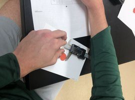 student using digital caliper