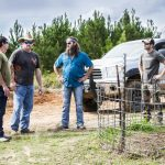"Bill Busbice, Terry Carr, Willie Robertson and Matt Busbice discussing a scene for the TV show ""Country Bucks"""