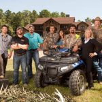 "From Left to Right: Matt Busbice, Ryan Busbice, B.J. Busbice, Joey Busbice, Mona Busbice, Bill Busbice and Terry Carr the cast of ""Country Bucks"""