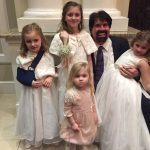 Bill and granddaughters Noel, Madeline, Chloe, and Emma cutting up at a wedding