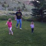 Bill Busbice playing with Emma and Ella