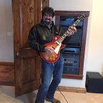 Bill Busbice playing the electric guitar