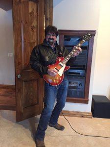 Bill Busbice playing an electric guitar
