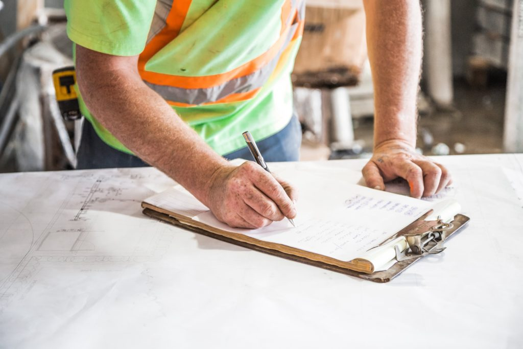 Technician reviewing HVAC energy audit paperwork.