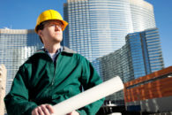 commercial buildings and worker with plans