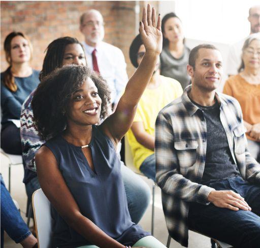 Woman raising hand in adult training class