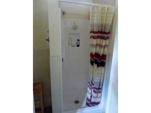 Clean token-operated shower