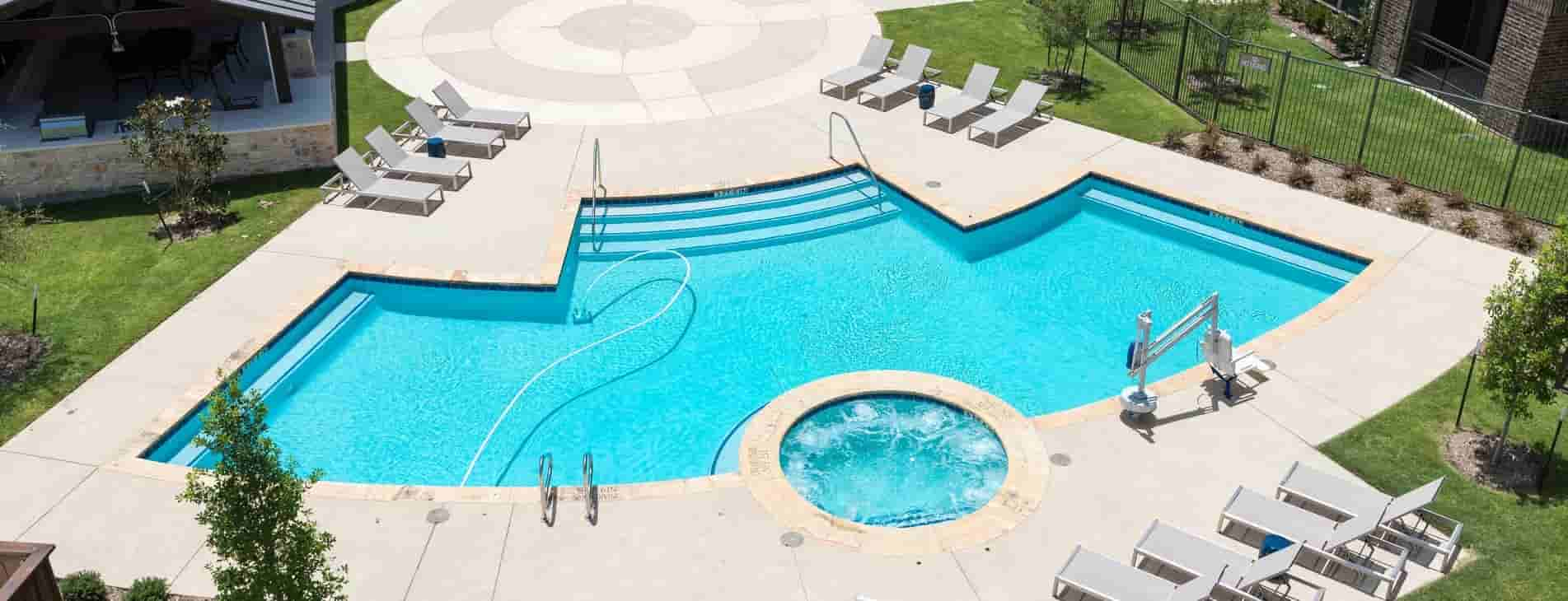 The poolside at Larkspur at Twin Creeks in Allen, TX