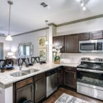 A wel-lit and spacious kitchen at Larkspur at Twin Creeks