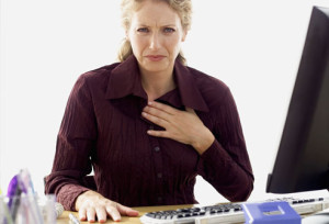 getty_rf_photo_of_woman_with_heartburn_at_work