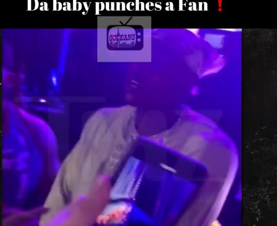 Da baby throws a swing at a fan !