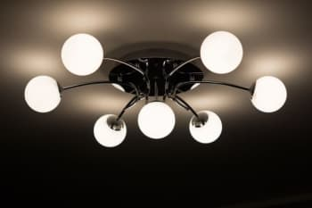 a modern ceiling light with 6 globes