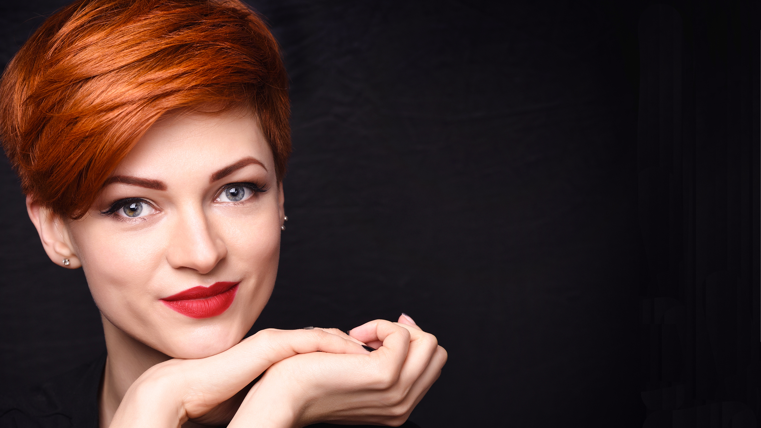 Woman with short red hair