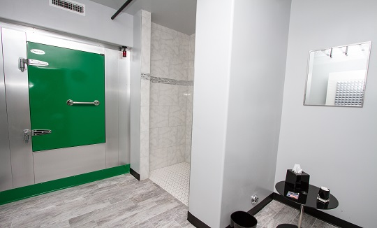 Location: Float Lab Westwood  Size: 5′ x 8′ Color: Brushed Aluminum with Bright Green Door