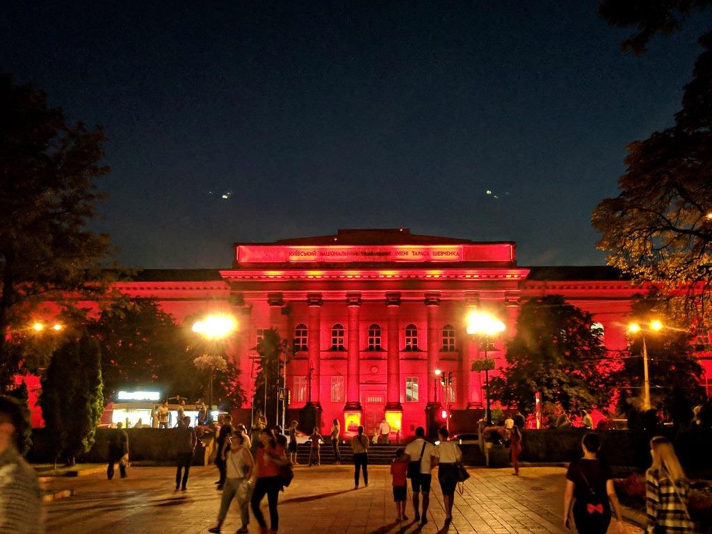 Taras Shevchenko University lit up red at night