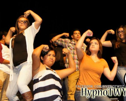Students on stage hypnotized